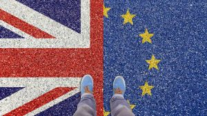 Photo of feet standing over the UK and EU flags